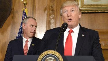 US Secretary of Interior Ryan Zinke (left) with Donald Trump in April last year.
