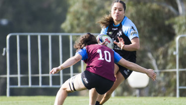 UC's Yasmin Meakes clatters into the defence.