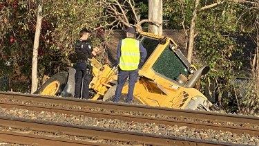 The excavator crashed through a rail corridor in Ipswich, damaging rail infrastructure.
