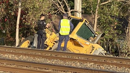 Man in front-end loader rammed shop, scooped up bikes, knocked out train lines