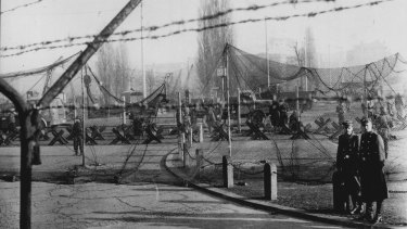 Camouflage nets, barbed-wire and anti-tank obstacles form the initial border fence to stem the flow of refugees fleeing East Germany.