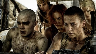 Charlize Theron as Furiosa (front right) driving the War Rig in Mad Max Fury Road.