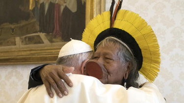 Pope Francis, left, embraces Chief Raoni Metuktire of the Kayapo Tribe in the Vatican on Monday. Raoni is travelling with a Xingu delegation to raise awareness of the threat to Amazon indigenous reserves.