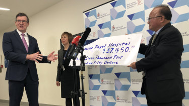 Acting Multicultural Affairs Minister Alan Tudge (left) was presented with a donation by Sunny Duong (right) in June.