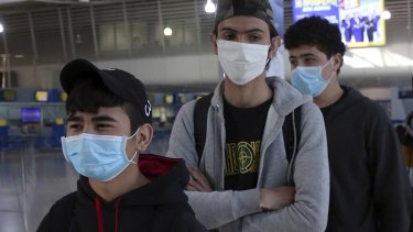 The risk of air travel can be reduced using facemasks.
