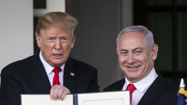 US President Donald Trump, left, and Benjamin Netanyahu, Israel's PM hold up a signed proclamation after a meeting at the White House in Washington, DC.