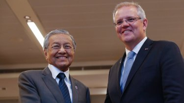 Malaysian Prime Minister Mahathir Mohamad (L) shakes hands with Australian Prime Minister Scott Morrison last month during a bilateral meeting on the sidelines of the Association of Southeast Asian Nations Summit in Singapore.