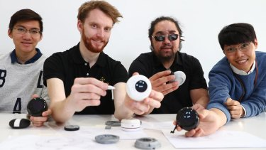 Co-founders of Brisbane start-up OSeyeris Jake Dean (second from left) and Yuma Decaux (third from left) with their digital tape measure for the visually-impaired.