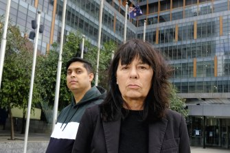 Uber drivers Syed Mubashir and Debra Weddall outside the Federal Court in Melbourne.