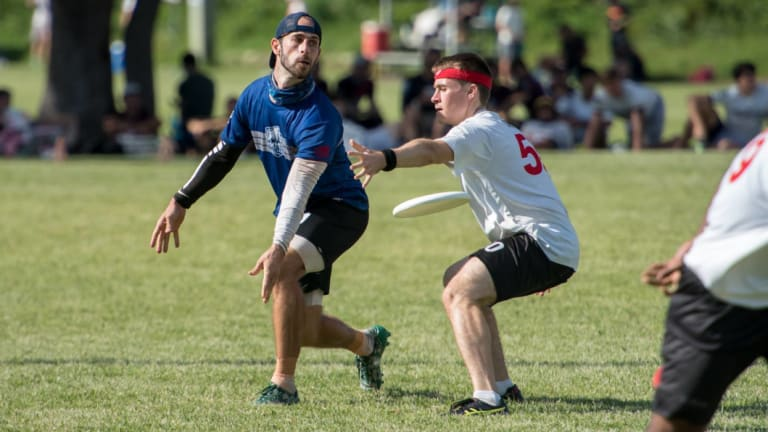 John McNaughton passing the disc during a game of Ultimate Frisbee.