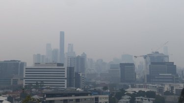 A smoke haze blankets Brisbane CBD on Monday morning.