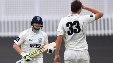 Cheshire grin: Steve Smith smiles at bowler Simon Mackin after clearing the field.