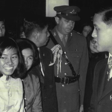 Thailand's Crown Prince talks briefly with a welcoming group of Thai students on his arrival at Sydney Airport in September 1970.