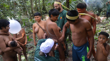 A Korubo woman is vaccinated by a Funai member during an expedition to the Javari Valley, in Brazil, last year.