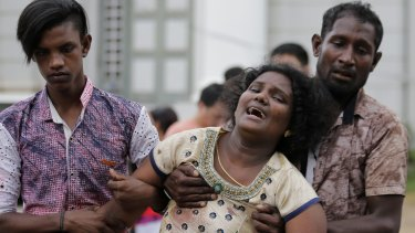 Relatives of a blast victim grieve outside a morgue in Colombo, Sri Lanka.