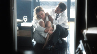Kim Basinger and Mickey Rourke in 9½ Weeks (1986).