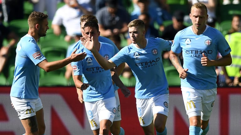 Spot on: Riley McGree of City (second from right) reacts after scoring a penalty goal to level proceedings against Newcastle at AAMI Park in Melbourne.