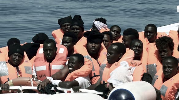 """his undated photo released on Tuesday, June 12, 2018, by French NGO """"SOS Mediterranee"""", shows stranded migrants aboard a Italian Coast Guard boat."""