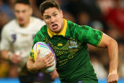 Mitchell Moses bursts into the clear to score a try for Australia in the final on Saturday night.