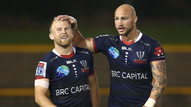 Rebels pair Billy Meakes and Andrew Deegan celebrate victory at Leichhardt Oval.