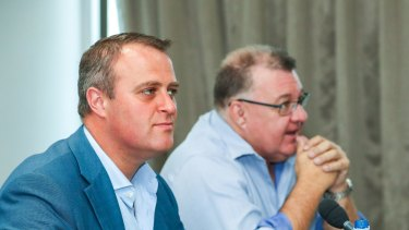 Liberal MPs Tim Wilson (left) and Craig Kelly (right) at a public hearing of the franking credits inquiry.