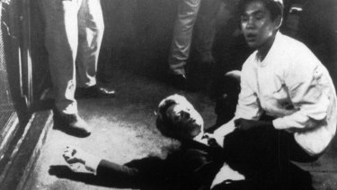 Juan Romero comforts Robert Kennedy after the shooting, having put rosary beads in his hand.