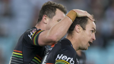 Just deserts: James Maloney is congratulated after sinking the Rabbitohs with a field goal.