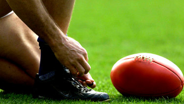 An amateur footballer was suspended after racially abusing an opposition player.