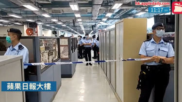 Hong Kong police cordon off the Apple Daily newsroom on Monday.