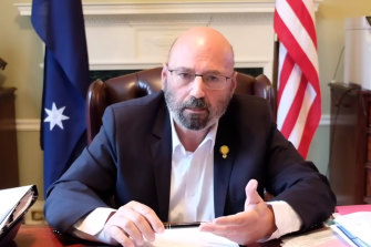 Arthur Sinodinos delivers a video message last month toall Australians in the US offering consular support.