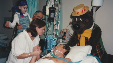 Andrew Taylor is visited in hospital by his sister Jenny (in surgical gown), terminally ill niece Emily and Humphrey B. Bear.
