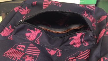 The snake inside the girl's schoolbag.
