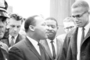 Martin Luther King jnr and Malcolm X wait for a press conference in March 1964.