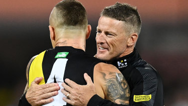 Damien Hardwick embraces Dustin Martin after the grand final