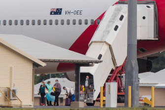 Australian evacuees from Diamond Princess arrive in Darwin on Thursday.