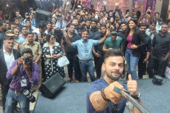 Another day at the office: Kohli takes a seflie at a Wrogn store launch in Hyderabad.