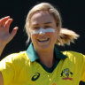 Ellyse Perry (centre) of Australia is congratulated by Alyssa Healy (left) and Beth Mooney.