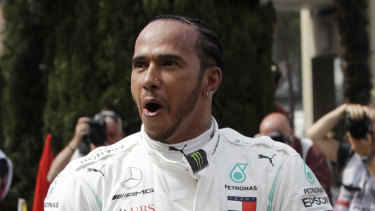 Frontrunner: Lewis Hamilton celebrates after securing pole position in Monaco.