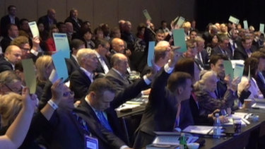 Liberal Party council members vote on a motion to sell the ABC in June.
