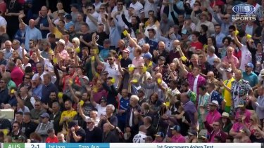 The Edgbaston crowd waves pieces of sandpaper at the Australians.