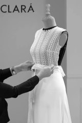 Designer Rosa Clara works on the wedding dress for Mery Perelló for her wedding with Rafael Nadal.The bodice, with jewel neckline and long sleeves, was made of beautiful Art Deco-inspired French lace with delicate patterning, flower motifs and microbeading on the meticulously hand-embroidered fabric.