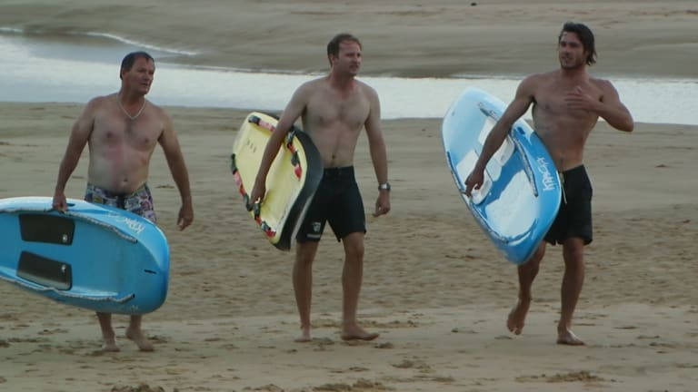 Lifeguards tried to save the men, who were washed up to 500 metres off shore.