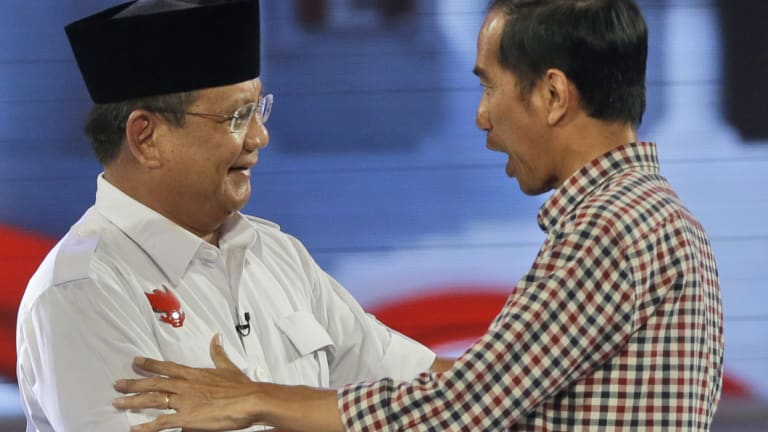 Joko Widodo, now Indonesia's President, shakes hands with his then opponent Prabowo after a 2014 debate.