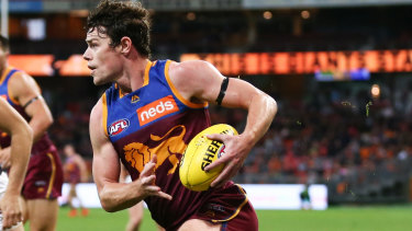 Running free: Lion Lachie Neale was 'pounded' by Port Adelaide players, says coach Chris Fagan.