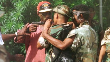 Corporal Allen, bodyguard of the sacked military commander, Brigadier-General Singirok, pulls his pistol on one of four soldiers who arrived at Murray Barracks in Port Moresby yesterday morning reportedly asking for food.