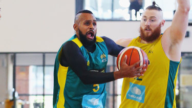 Driving hard: NBA stars Patty Mills and Aron Baynes in Boomers practice.