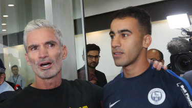 Former Socceroo Craig Foster with refugee footballer Hakeem al-Araibi at Melbourne International Airport on Tuesday,
