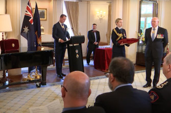 "An investiture  ceremony at Government House. ""They really are a joyous occasion,"" says Governor-General David Hurley (at far right)."