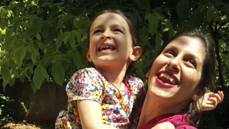 Nazanin Zaghari-Ratcliffe hugs her daughter Gabriella, in Iran.