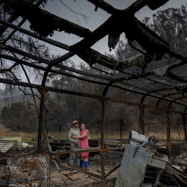 Mark Brooks with his daughter Kylee at his home, which was destroyed by bushfires.